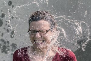 woman being splashed with water